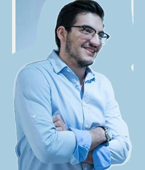 John smiling in blue shirt